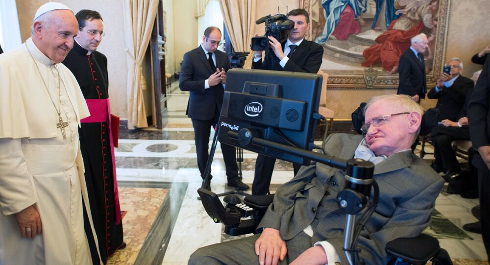 Pope Francis (L) meeting with English theoretical physicist and cosmologist Stephen Hawking at the Vatican