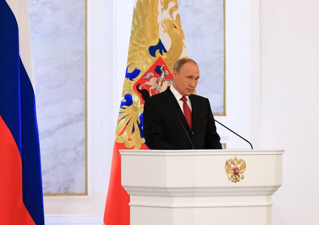 Russian President Vladimir Putin delivers his Annual Presidential Address to the Federal Assembly at the Kremlin's St. George Hall