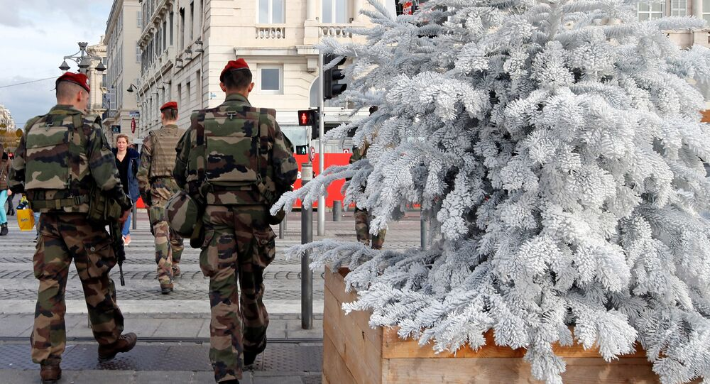 French soldiers patrol past a Christmas market in Marseille, France, November 23, 2016