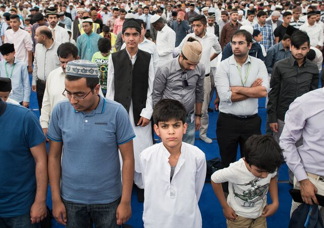 Members of the Ahmadiyya Muslim community are led in prayer by the fifth Caliph of the Ahmadiyya faith, Mirza Masroor Ahmad, during an annual three-day event, known as the Jalsa Salana, in Hampshire on August 21, 2015.