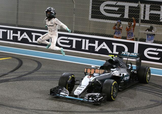 Mercedes driver Nico Rosberg of Germany celebrates after finishing second to win the 2016 world championship during the Emirates Formula One Grand Prix at the Yas Marina racetrack in Abu Dhabi, United Arab Emirates, Sunday, Nov. 27, 2016