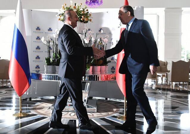 Russian Foreign Minister Sergei Lavrov, right, and Turkish Foreign Minister Mevlut Cavusoglu meet in Turkey