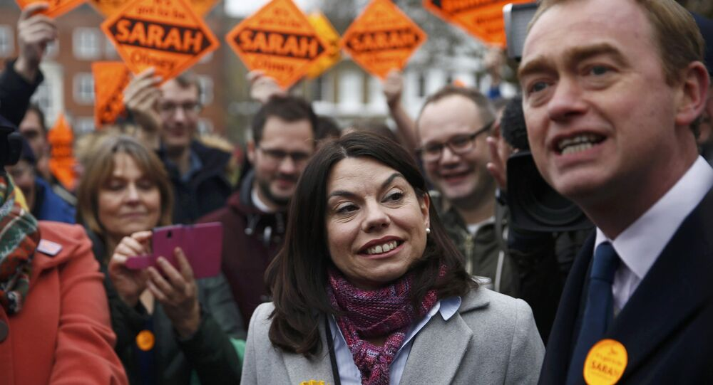 Liberal Democrats winner of the Richmond Park by-election, Sarah Olney, celebrates her victory with party leader Tim Farron on Richmond Green in London, Britain December 2, 2016.