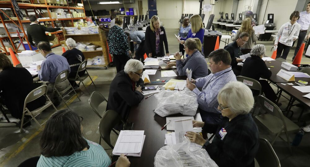Workers begin a statewide presidential election recount Thursday, Dec. 1, 2016, in Milwaukee