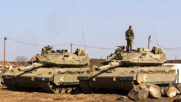 An Israeli soldier stands on top of a Merkava tank near the border with Syria in the Israeli-annexed Golan Heights, on November 28, 2016 - Sputnik International