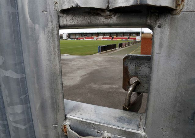 The Crewe Alexandra Football Club ground is seen through a hole in a locked gate in Crewe, Britain November 27, 2016