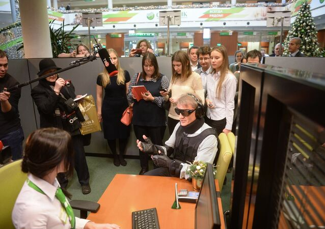 Herman Gref, center, president and Chairman of Executive Board at Sberbank of Russia, during the launch of a project to adapt the bank's services and products to physically challenged people