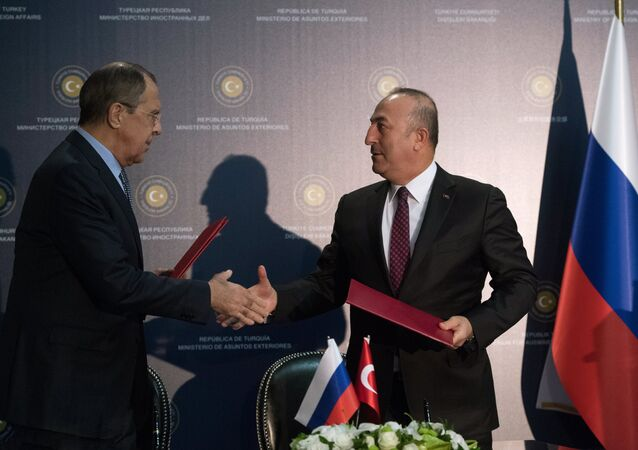 Russian Foreign Minister Sergei Lavrov, left, and Turkish Foreign Minister Mevlut Cavusoglu during the signing of joint documents following a meeting in Turkey