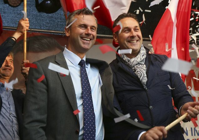 In this May 20, 2016 file photo Norbert Hofer candidate for presidential elections of Austria's Freedom Party, FPOE, and Heinz-Christian Strache, from left, head of Austria's Freedom Party, FPOE, look out at supporters during the final election campaign event in Vienna