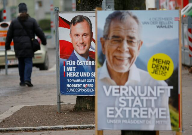 A man passes presidential election campaign posters of far right Freedom Party (FPOe) presidential candidate Norbert Hofer and Alexander Van der Bellen, who is supported by the Greens, in Vienna, Austria, December 1, 2016