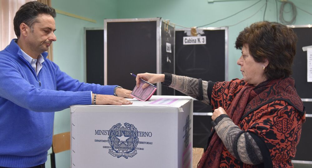A woman casts her ballot for a referendum on constitutional reforms, on December 4, 2016 in a polling station in Rome