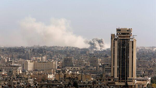 A general view shows rising smoke after strikes on Aleppo city, Syria December 3, 2016 - Sputnik International