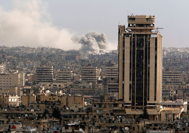 A general view shows rising smoke after strikes on Aleppo city, Syria December 3, 2016