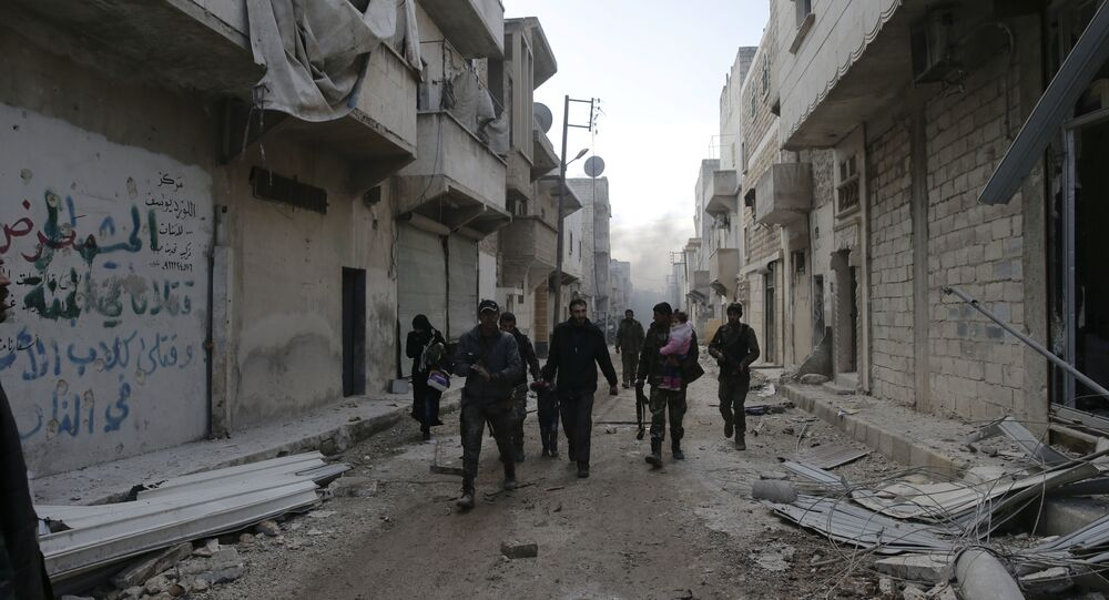 Syrian army soldiers help a family fleeing rebel-held eastern neighborhoods of Aleppo into the Tariq Al Bab area that is controlled by Syrian government forces East of Aleppo, Syria, Saturday, Dec. 3, 2016
