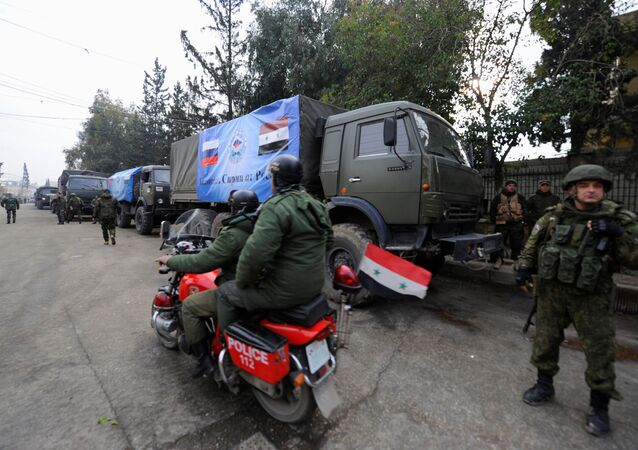 Russian soldiers stand near their vehicles in Aleppo, Syria December 4, 2016