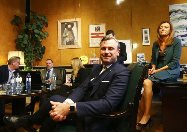 Austrian far-right Freedom Party (FPOe) presidential candidate Norbert Hofer and his wife Verena wait for the first projections in his office in Vienna, Austria, December 4, 2016