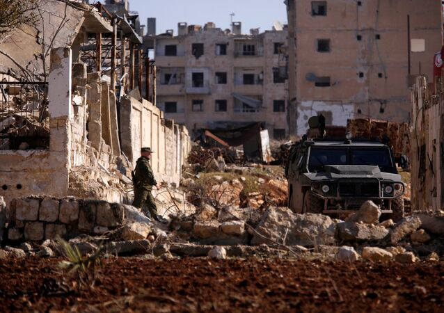 A Russian soldier walks to a military vehicle in goverment controlled Hanono housing district in Aleppo, Syria December 4, 2016