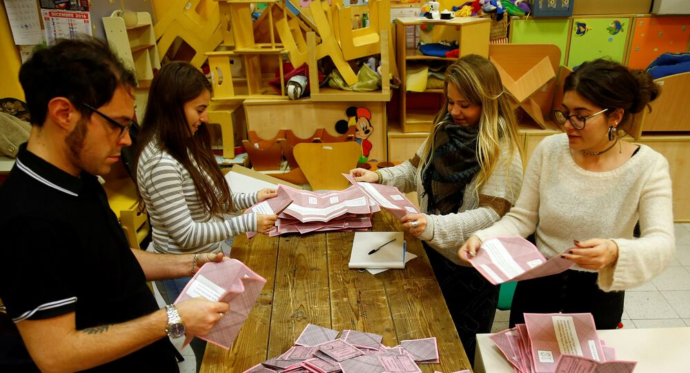 Volunteers count ballots for a referendum on constitutional reform at a polling station in Rome, Italy, December 4, 2016