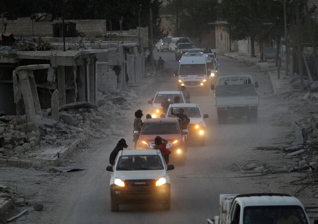 Rebel fighters drive their vehicles celebrating what they said was the taking over of Baraghedeh and Kafr-Ghan towns, in al-Rai town, northern Aleppo countryside, Syria October 10, 2016