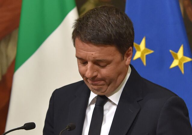 Italy's Prime Minister Matteo Renzi announces his resignation during a press conference at the Palazzo Chigi following the results of the vote for a referendum on constitutional reforms, on December 5, 2016 in Rome.
