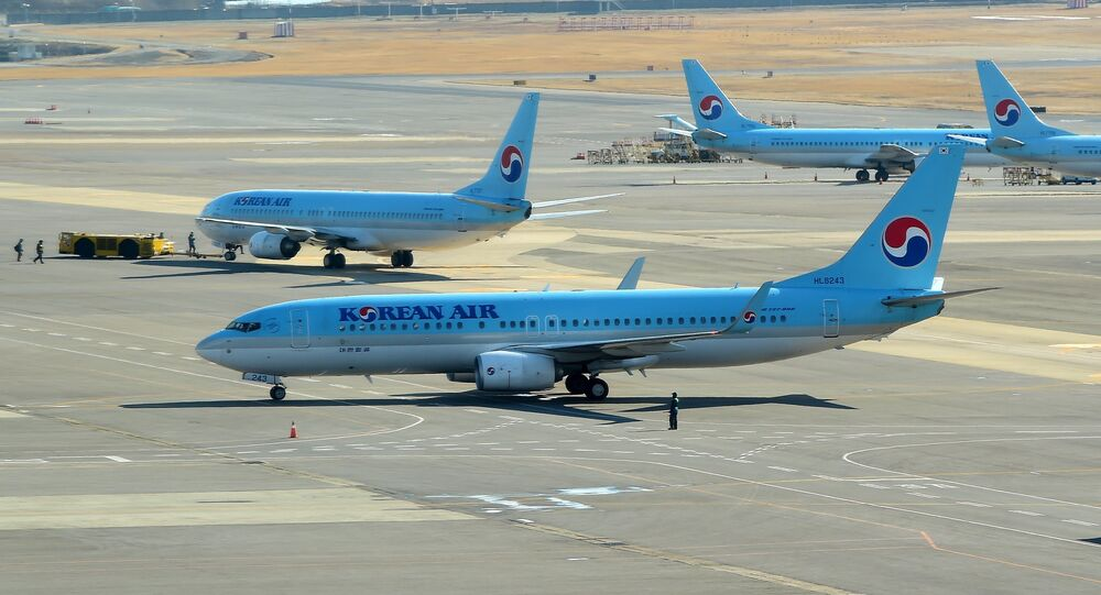 South Korea's Korean Air planes sit on the tarmac at Gimpo airport in Seoul on December 16, 2014