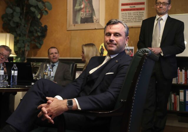 Norbert Hofer, center, candidate of the right-wing populist Freedom Party, poses for a photograph as he and his aides wait in his office in Austria's capital Vienna before the voting closes Sunday, Dec. 4, 2016