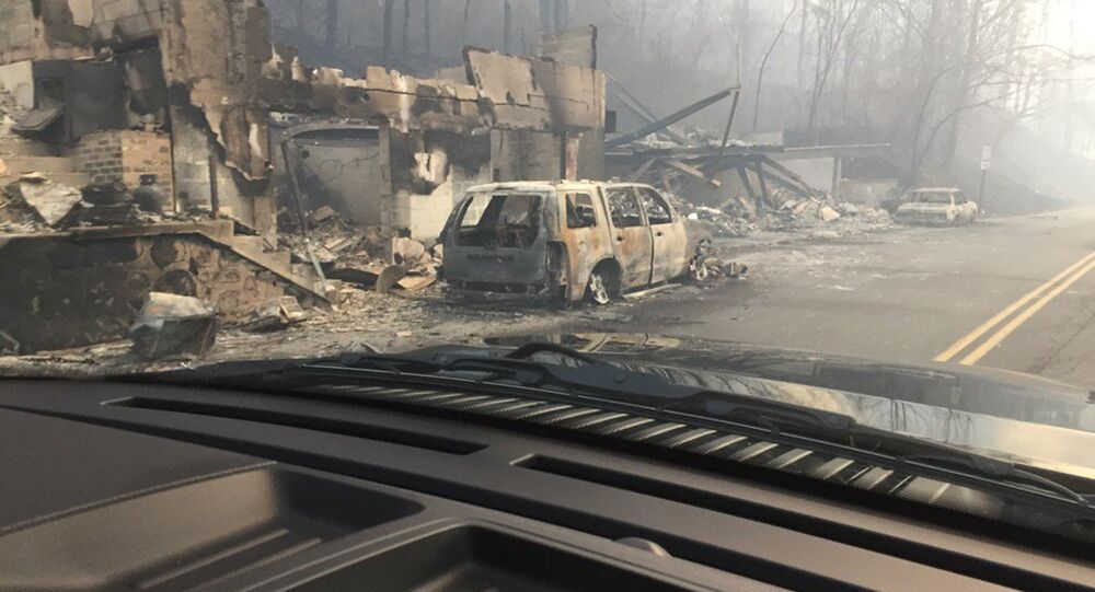 Burned buildings and cars aftermath of wildfire is seen in this image released in social media by Tennessee Highway Patrol in Gatlinburg, Tennessee, U.S. on November 29, 2016
