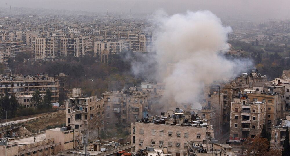 Smoke rises near Bustan al-Qasr crossing point in a government controlled area, during clashes with rebels in Aleppo, Syria December 5, 2016