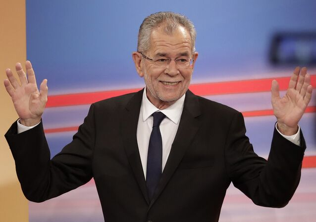Presidential candidate Alexander Van der Bellen, a former leading member of the Greens Party, raises his arms in the Hofburg in Austria's capital Vienna Sunday, Dec. 4, 2016
