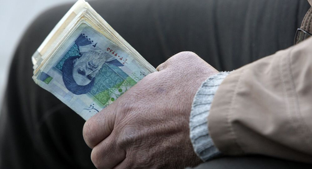 Iranian street money changer holds Iranian banknotes (File)