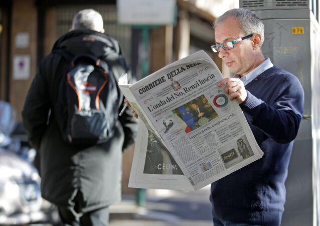 A man reads the Corriere della Sera newspaper in downtown Rome, Italy, December 5, 2016.