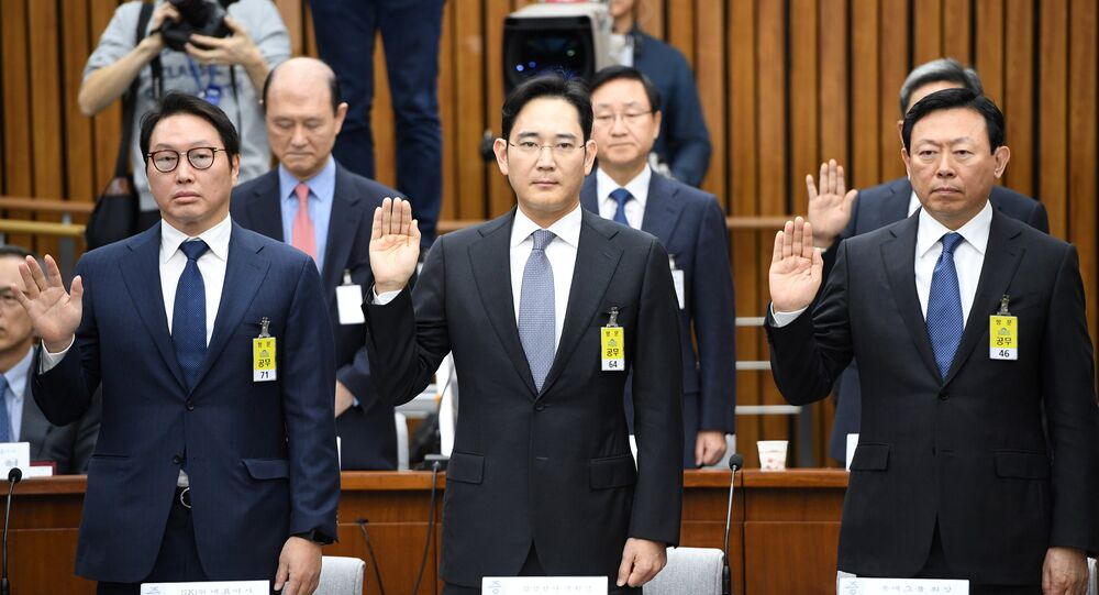 (L-R) SK Group chairman Chey Tae-Won, Samsung Group's heir-apparent Lee Jae-yong and Lotte Group Chairman Shin Dong-Bin take an oath during a parliamentary probe into a scandal engulfing President Park Geun-Hye at the National Assembly in Seoul on December 6, 2016