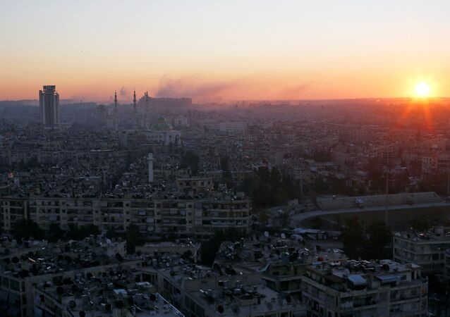 The sun rises while smoke is pictured near Aleppo's historic citadel, as seen from a government-controlled area of Aleppo, Syria December 6, 2016.