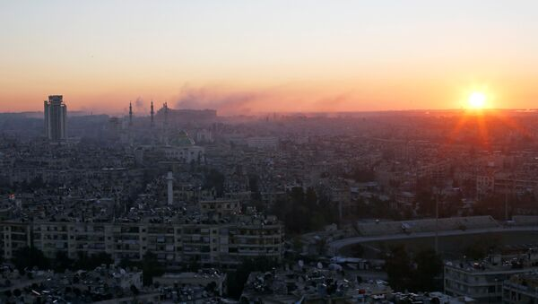 The sun rises while smoke is pictured near Aleppo's historic citadel, as seen from a government-controlled area of Aleppo, Syria December 6, 2016. - Sputnik International