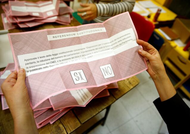 A volunteer counts ballots for a referendum on constitutional reform at a polling station in Rome, Italy, December 4, 2016.