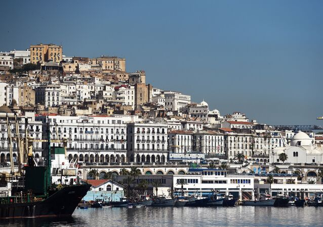 A general view taken on June 5, 2014 shows the Grand Mosque (R) situated on the promenade along the Bay of Algiers with the old town of the Algerian capital known as the Kasbah in the background.