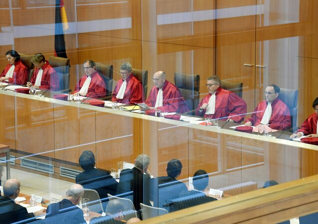 The first senate of Germany's Constitutional Court with its members (L-R) Yvonne Ott, Susanne Baer, Johannes Masing, Michael Eichberger, Ferdinand Kirchhof (chairman), Wilhelm Schluckebier, Andreas Paulus and Gabriele Britz give their judgement on compensations over nuclear phase-out in Karlsruhe, southern Germany