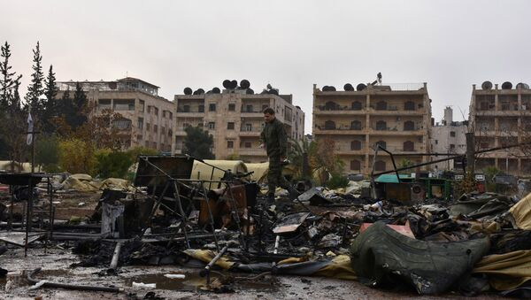 A Russian soldier inspects the damage at a Russian military field hospital after it was shelled by what the Russian Defence Ministry said were Syrian rebels in Aleppo, Syria, in this handout picture provided by SANA on December 5, 2016. - Sputnik International