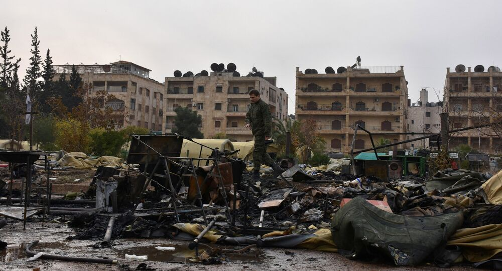 A Russian soldier inspects the damage at a Russian military field hospital after it was shelled by what the Russian Defence Ministry said were Syrian rebels in Aleppo, Syria, in this handout picture provided by SANA on December 5, 2016.