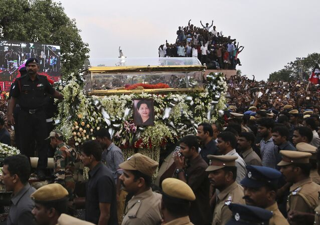 A glass casket carrying body of India's popular politician and former film actress Jayaram Jayalalithaa is taken in a funeral procession in Chennai, India, Tuesday, Dec. 6, 2016. Jayalalithaa, chief minister of Tamil Nadu state, died overnight following a heart attack a day earlier.