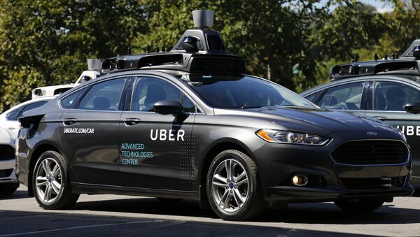 A group of self driving Uber vehicles position themselves to take journalists on rides during a media preview at Uber's Advanced Technologies Center in Pittsburgh, Monday, Sept. 12, 2016. - Sputnik International
