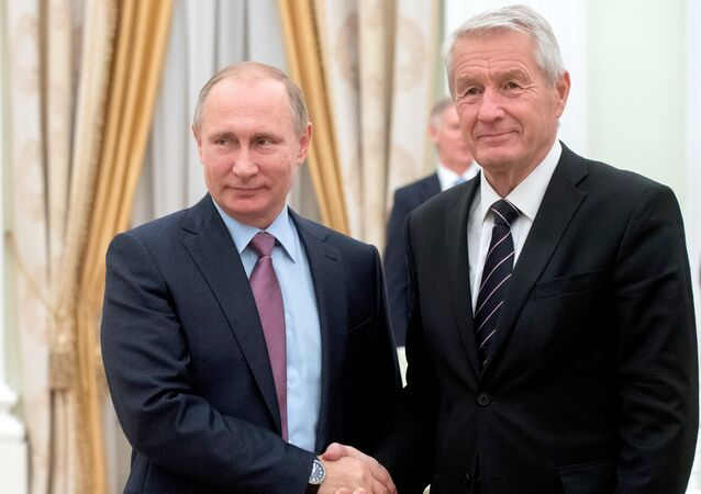 Russian President Vladimir Putin shakes hands with Council of Europe Secretary General Thorbjorn Jagland during their meeting at the Kremlin in Moscow, Russia