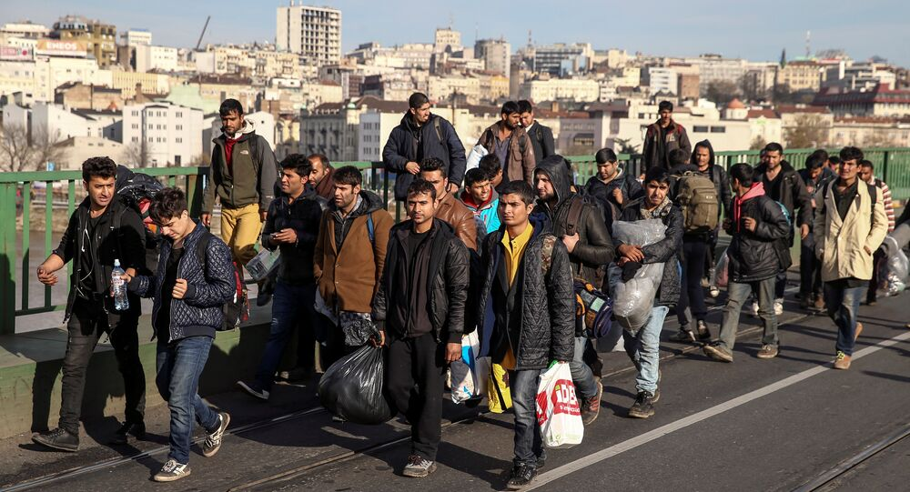 Refugees and migrants cross the Old Sava Bridge heading in the direction of the Croatian border, in Belgrade, Serbia November 11, 2016.