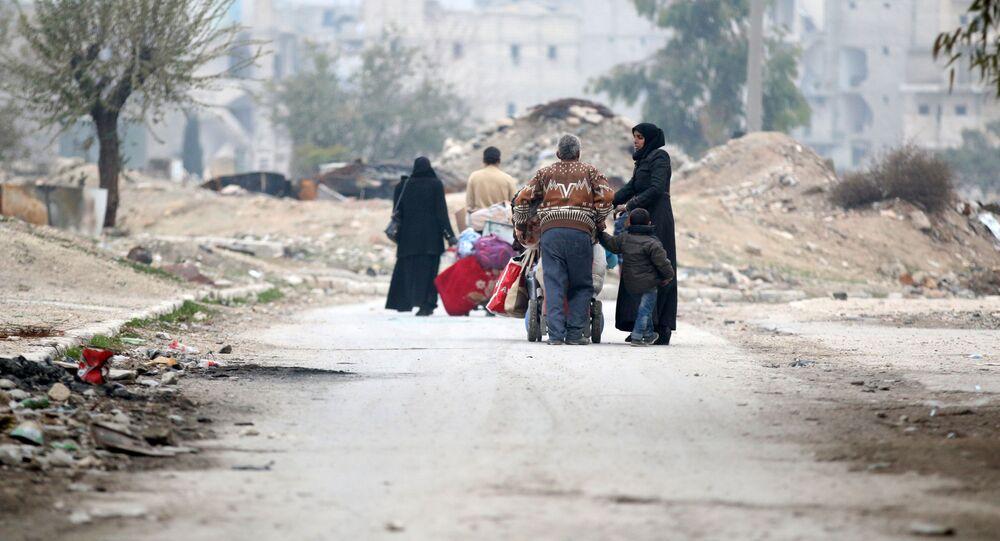 People carry their belongings as they flee the Kadi Askar area towards Bustan al-Qasr neighbourhood, in rebel-held besieged Kadi Askar area of Aleppo, Syria December 5, 2016.