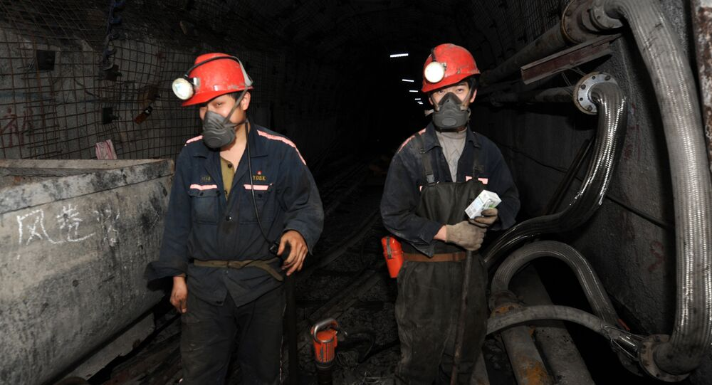 Laborers working at a coal mining facility