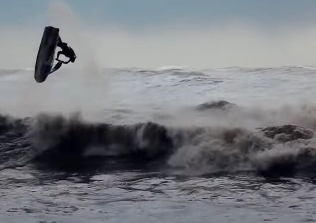 Fearless Russian Daredevils Ride Wave During Storm in Sochi