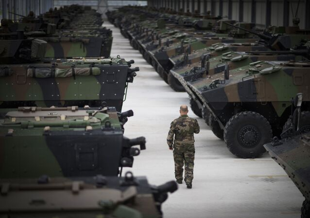 A man walks among VBCI armored vehicles on June 9, 2015 at Mourmelon military camp, northeastern France