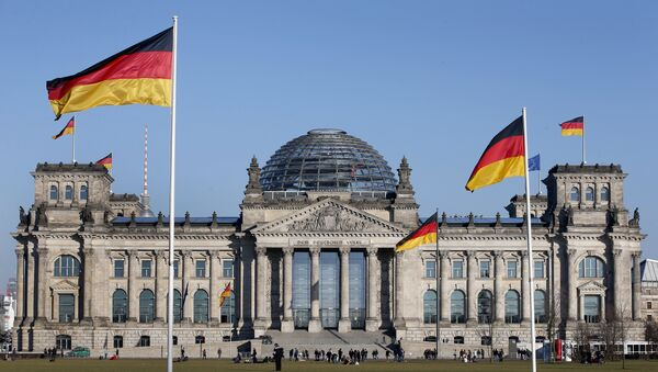 German flags wave in front of the Reichstag building, host of the German Federal Parliament Bundestag, in Berlin, Germany. (File) - Sputnik International