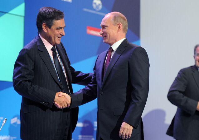 Vladimir Putin and Francois Fillon at the Valdai discussion club in 2013