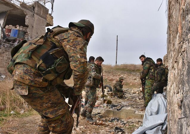 Syrian pro-government troops hold a position in Aleppo's eastern Karm al-Jabal neighborhood as they advance towards al-Shaar neighbourhood on December 5, 2016 during their offensive to retake Syria's second city.